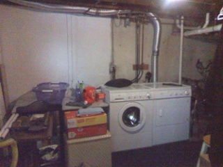 Unfinished laundry area is what basement was like before