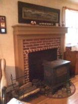 """The mantle with new """"legs"""" on the sides and some molding"""