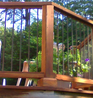 The new railing and round metal balusters