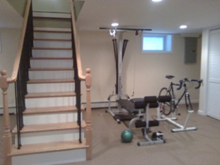 exercise area at bottom of stairs